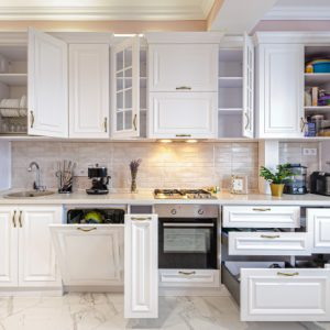 luxury-modern-white-kitchen-interior-with-open-doors-drawers_97070-1505