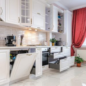 luxury-modern-white-kitchen-interior-with-open-doors-drawers_97070-1549